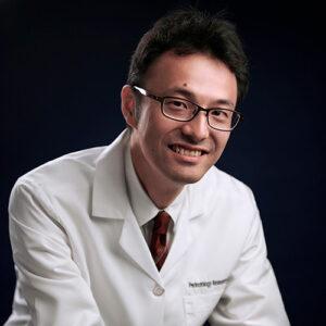 KENICHIRO MOTOMURA, M.D., PH.D.